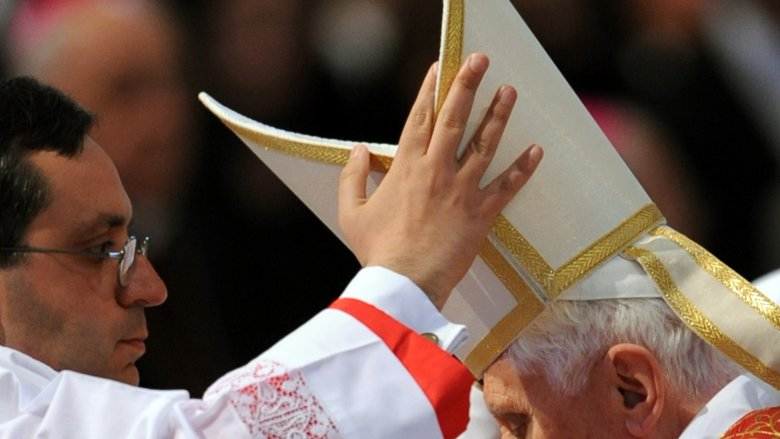 putting on pope hat