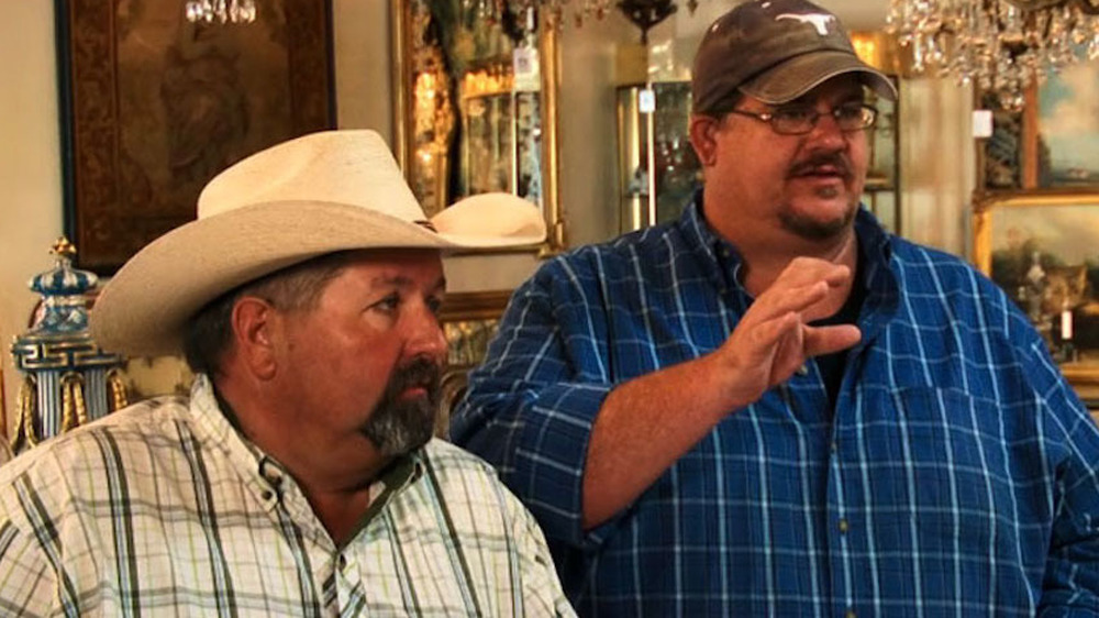 Randy Smith and Bubba Smith wearing hats