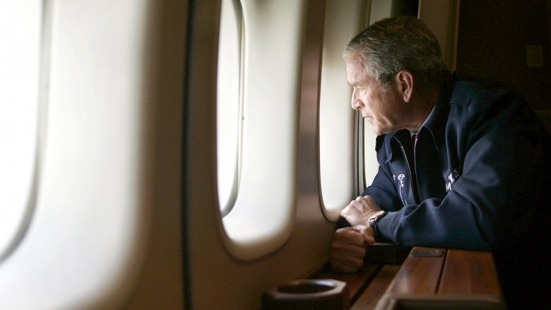 George W. Bush looks out the window of Air Force One