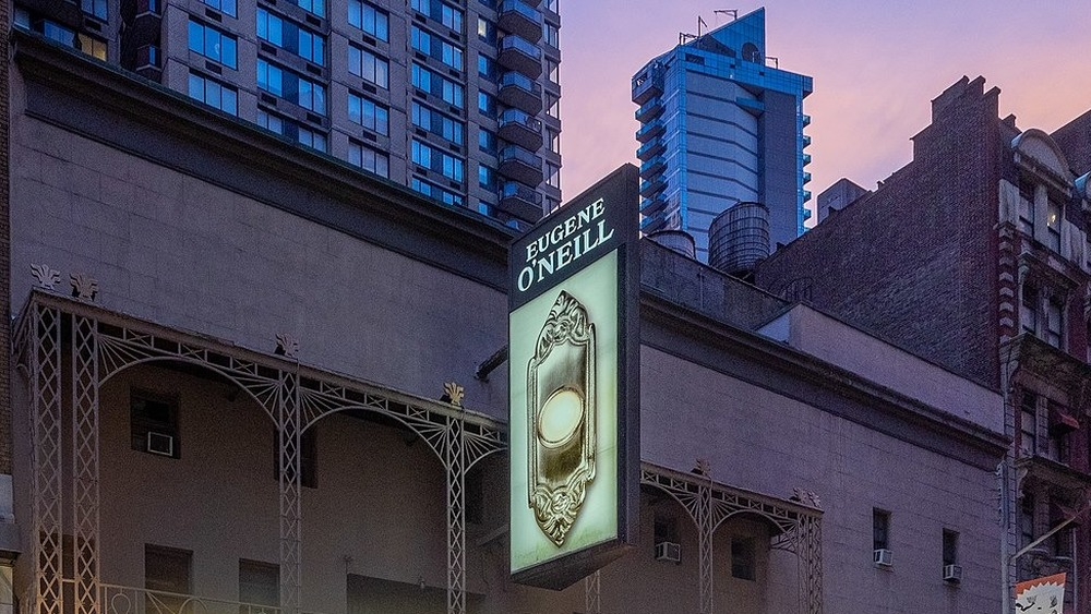 Eugene O'Neill Theatre on Broadway with sign for The Book of Mormon