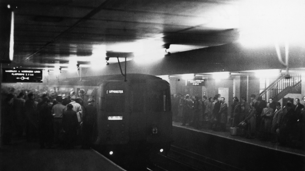 People huddled underground avoiding smog.