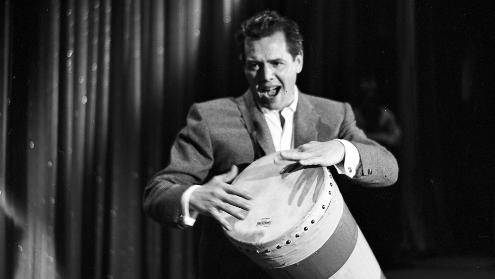 Desi Arnaz playing bongo drum