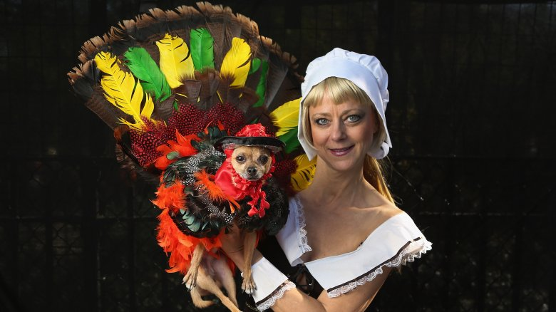 woman and dog dressed as Pilgrim and turkey