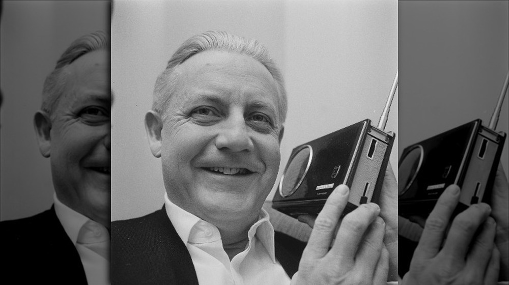 Director Robert Wise holds a camera