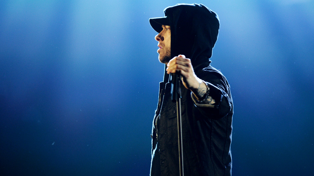 Eminem with hand on microphone