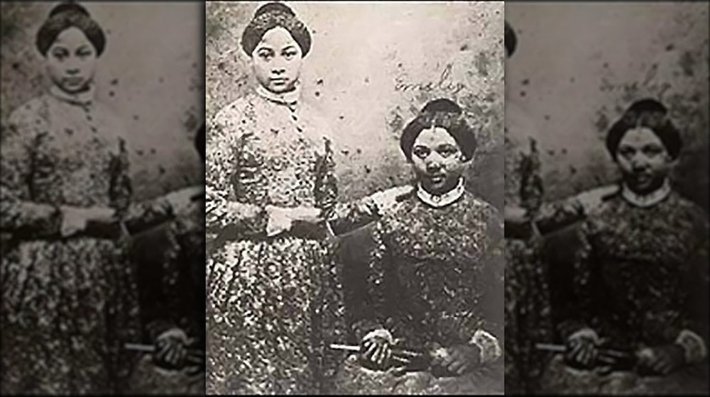 Freed sisters Mary and Emily Edmonson, standing